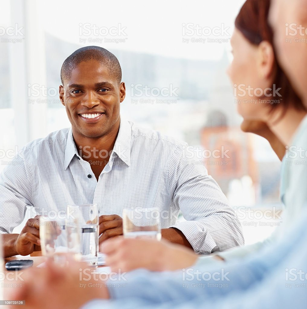 Smiling middle aged business man in a meeting royalty-free stock photo