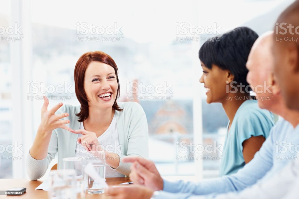 Smiling middle aged business woman discussing in a meeting royalty-free stock photo