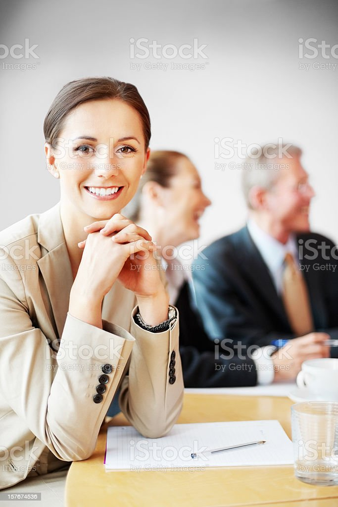 Smiling middle aged business woman in meeting at office royalty-free stock photo