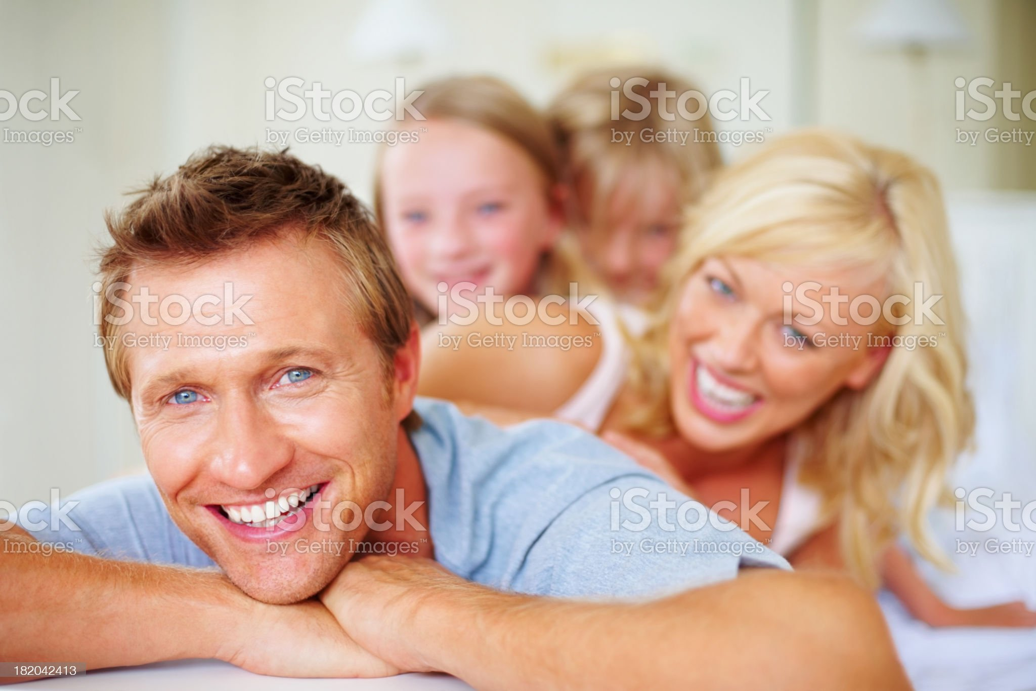 Smiling middle aged man with his family in background royalty-free stock photo