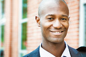 Smiling middle aged professional black man close-up outdoors portrait