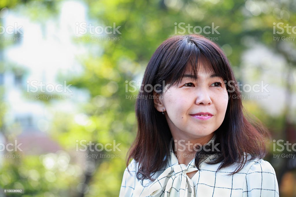 smiling middle aged woman stock photo