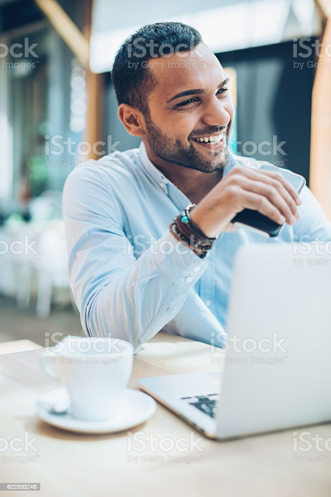 Smiling Middle Eastern ethnicity businessman stock photo