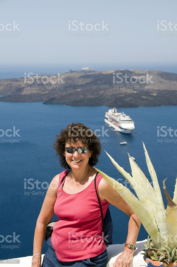 smiling middle-age tourist in santorini greece royalty-free stock photo
