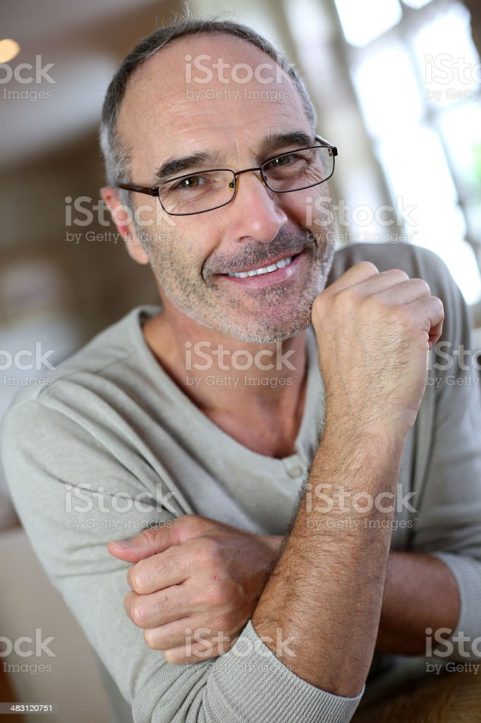 Smiling middle-aged man with eyeglasses looking at camera royalty-free stock photo