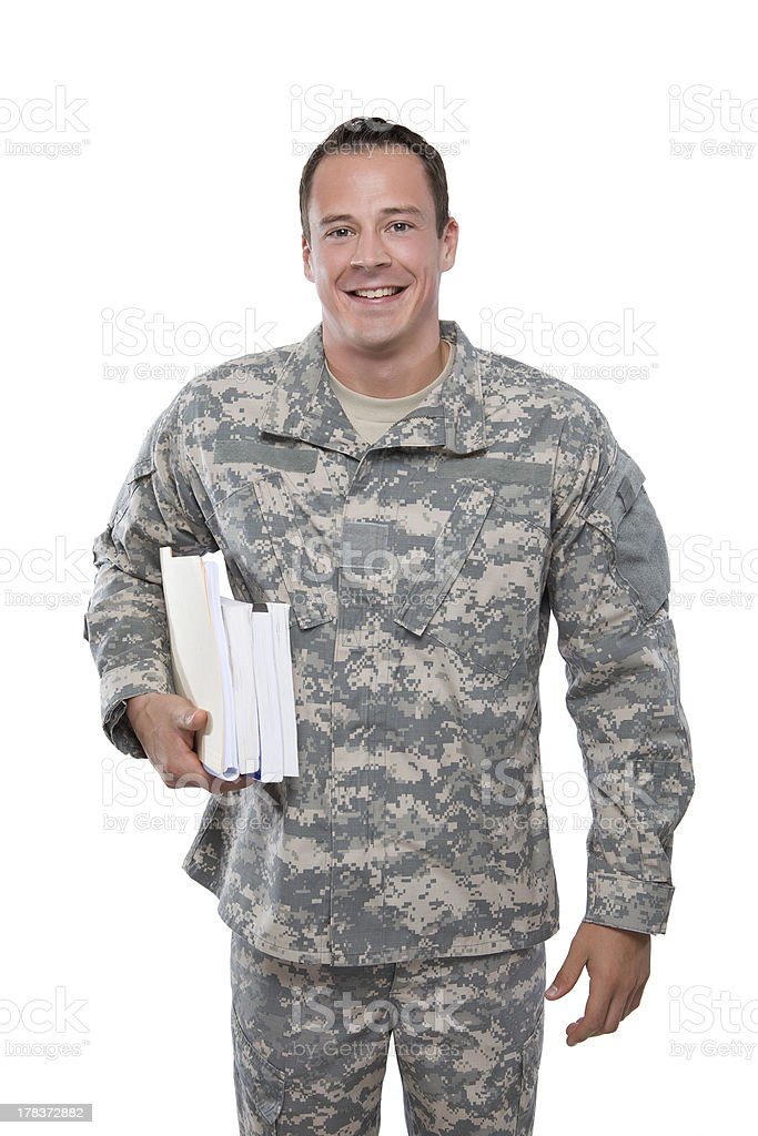 Smiling military man in uniform carrying school books stock photo