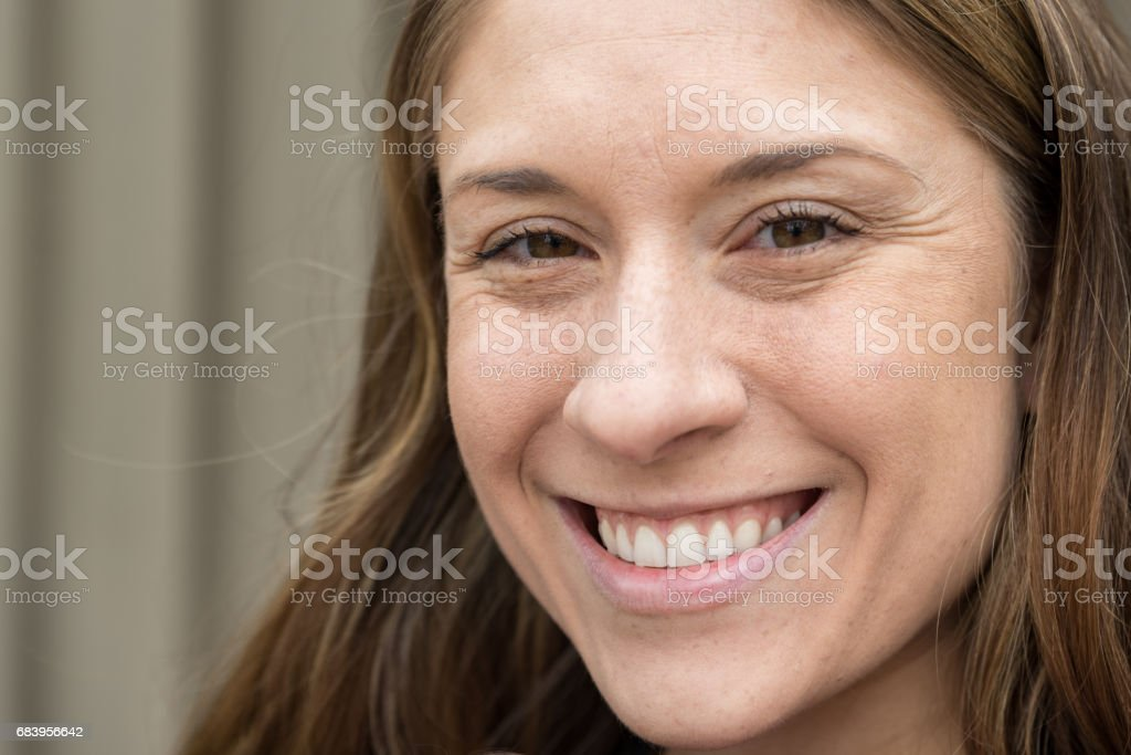 Smiling Millennial Women With Brown Hair stock photo