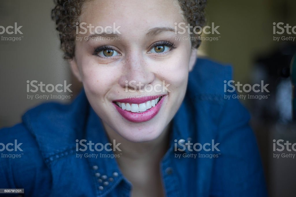 Smiling mixed woman stock photo