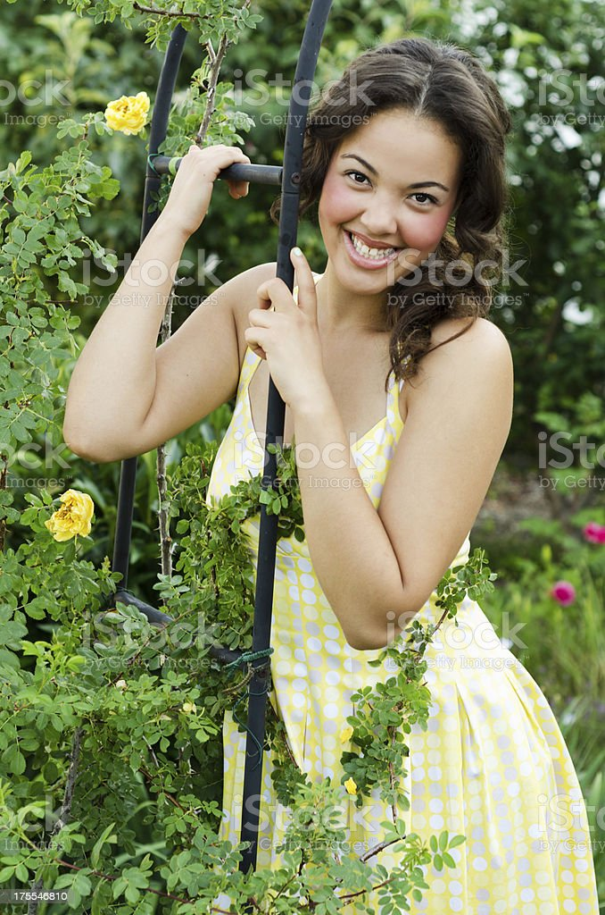 Smiling mixed-race teen girl in garden. stock photo
