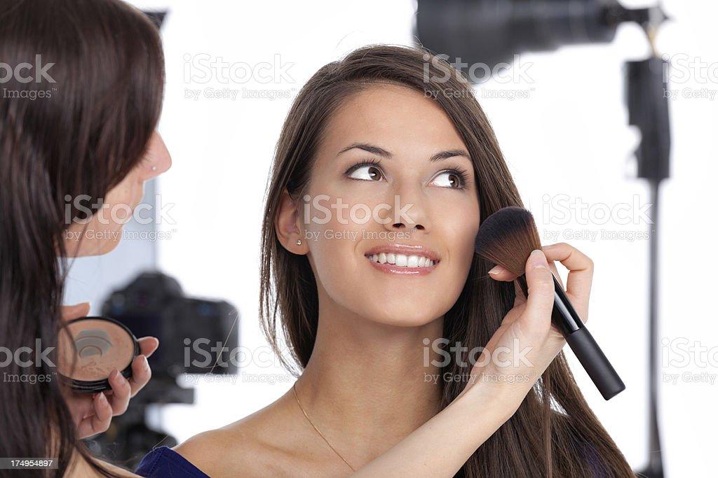 smiling model makeup artist photo shot stock photo