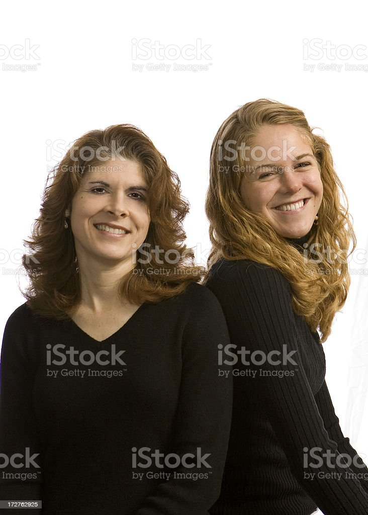 smiling mom and daughter in black royalty-free stock photo