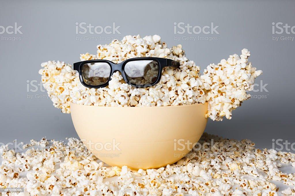 Smiling Monster of popcorn, glasses stock photo