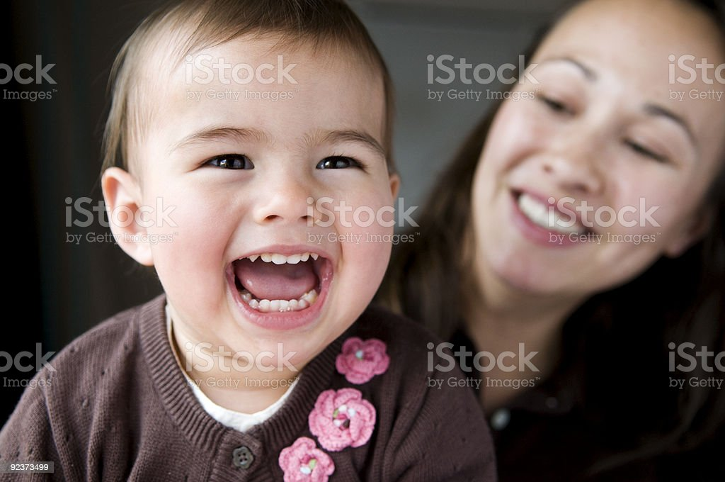 Smiling mother and child with pink flowers  stock photo