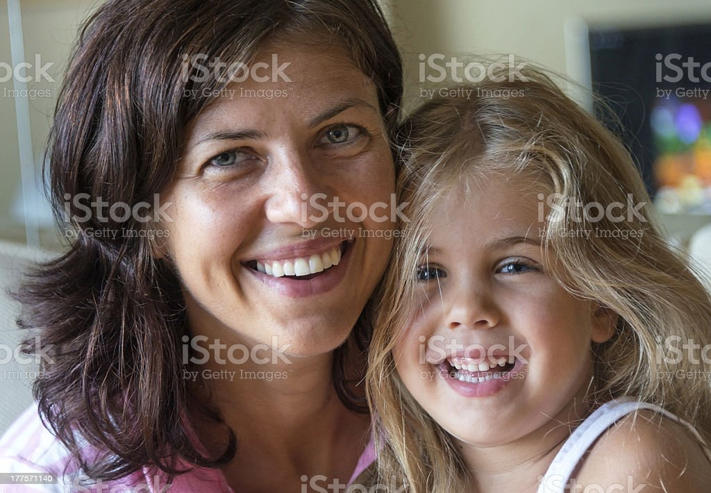 Smiling mother and daughter royalty-free stock photo