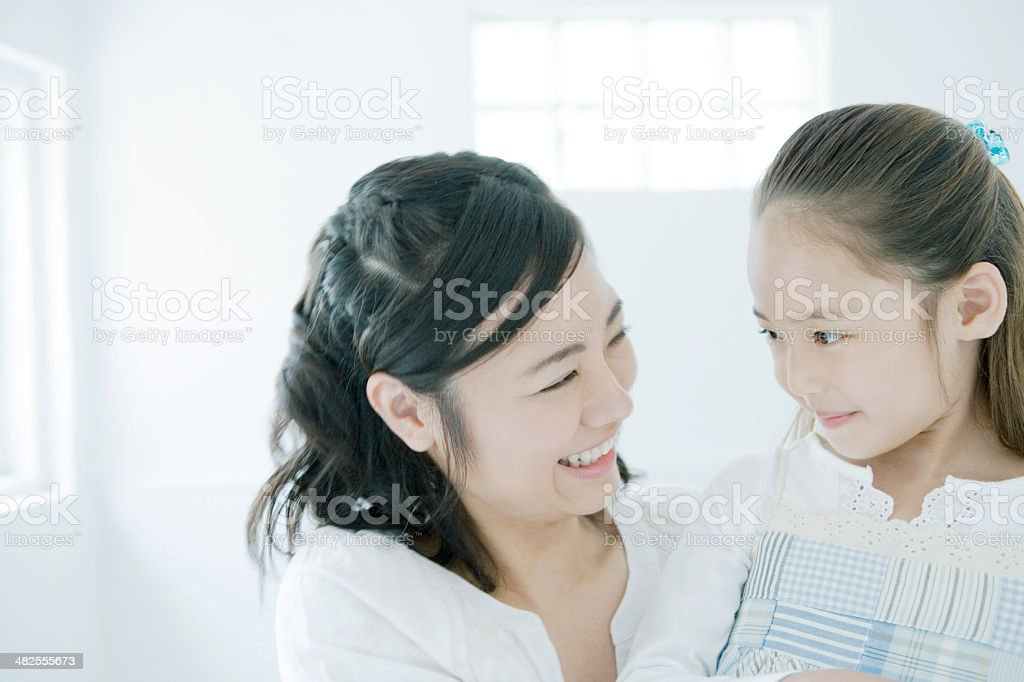 Smiling mother and daughter stock photo