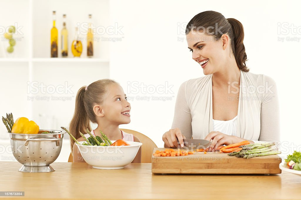 Smiling Mother And Daughter Preparing Food royalty-free stock photo