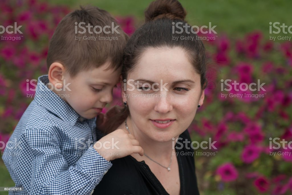 smiling mother and her cute little son stock photo