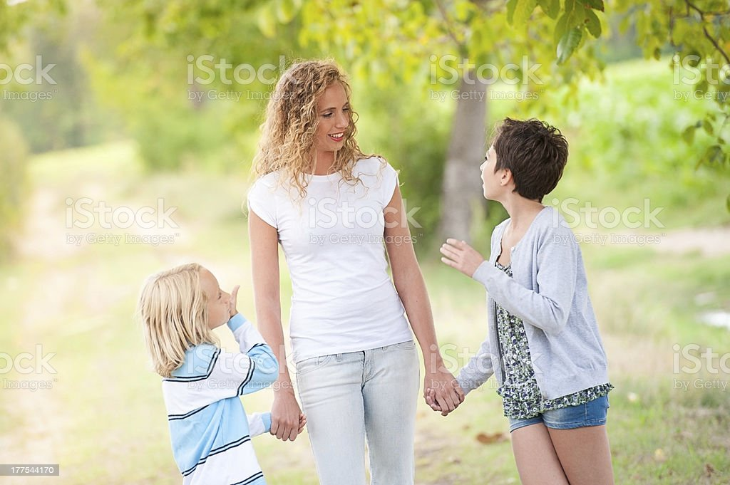 Smiling mother and little sons - family happiness royalty-free stock photo