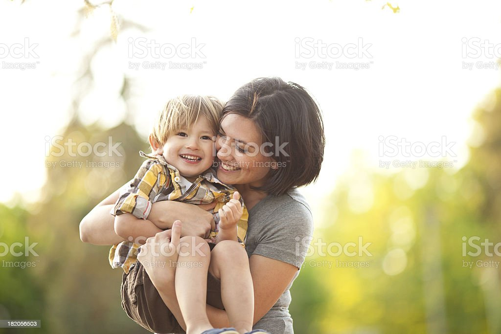 Smiling mother and son outdoors royalty-free stock photo