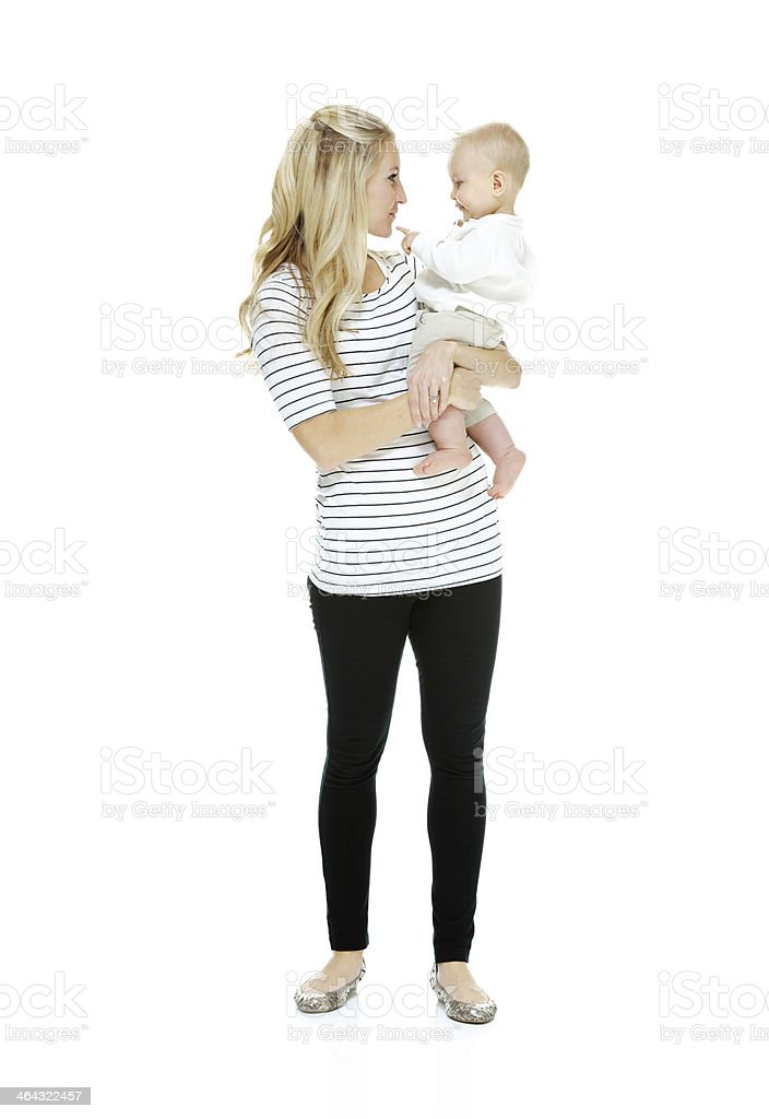 Smiling mother bonding with her baby royalty-free stock photo