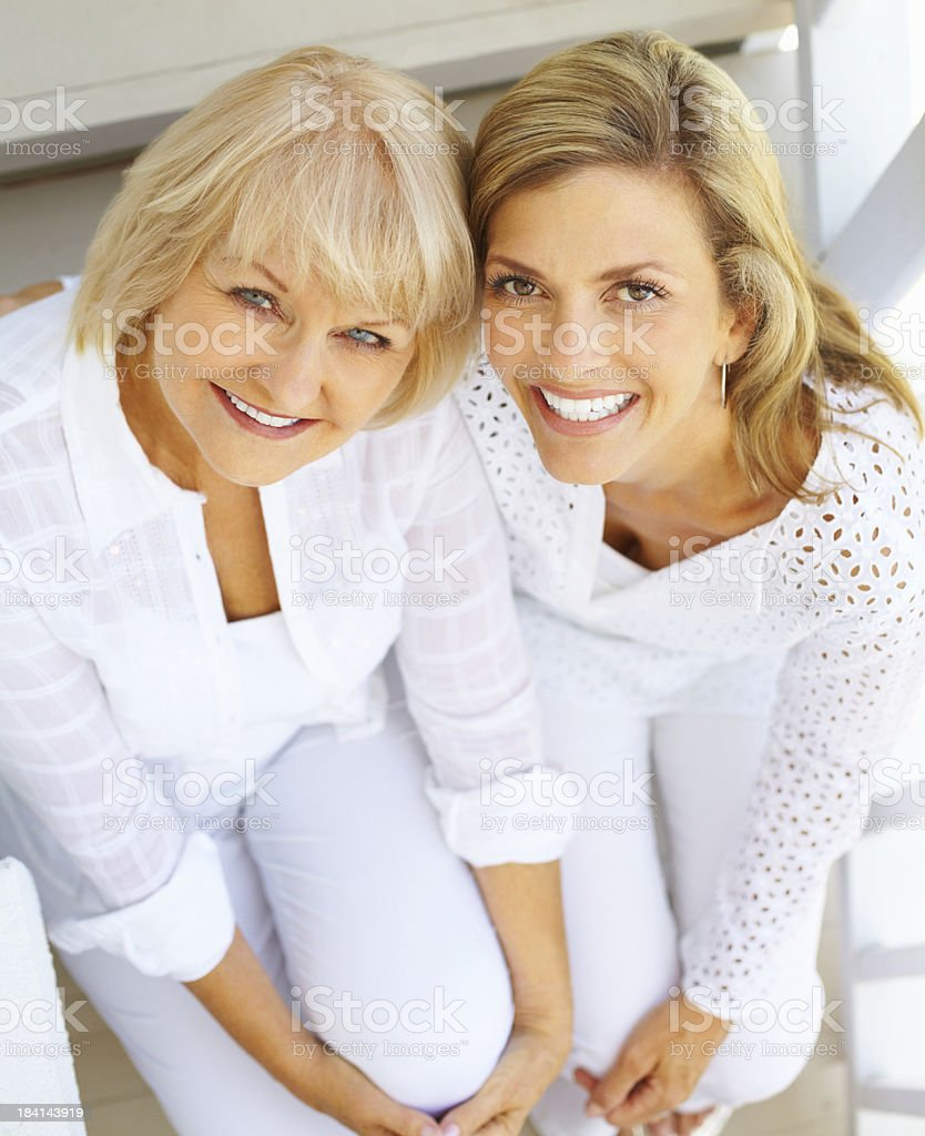 Smiling mother with happy, middle-aged daughter royalty-free stock photo