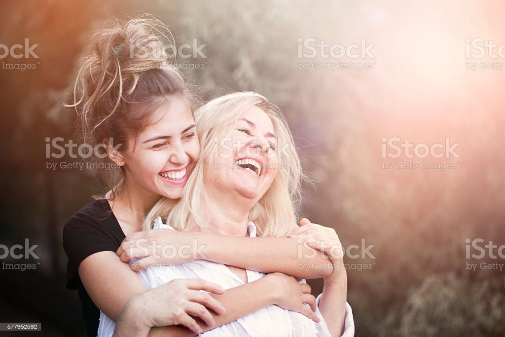Smiling mother with young daughter stock photo