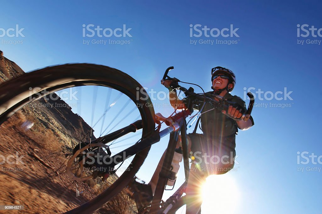 smiling mountain biking woman and sunshine royalty-free stock photo