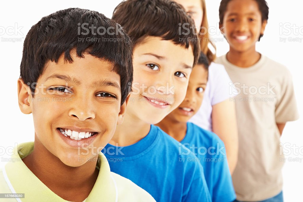 Smiling multi ethnic kids standing in a line against white royalty-free stock photo