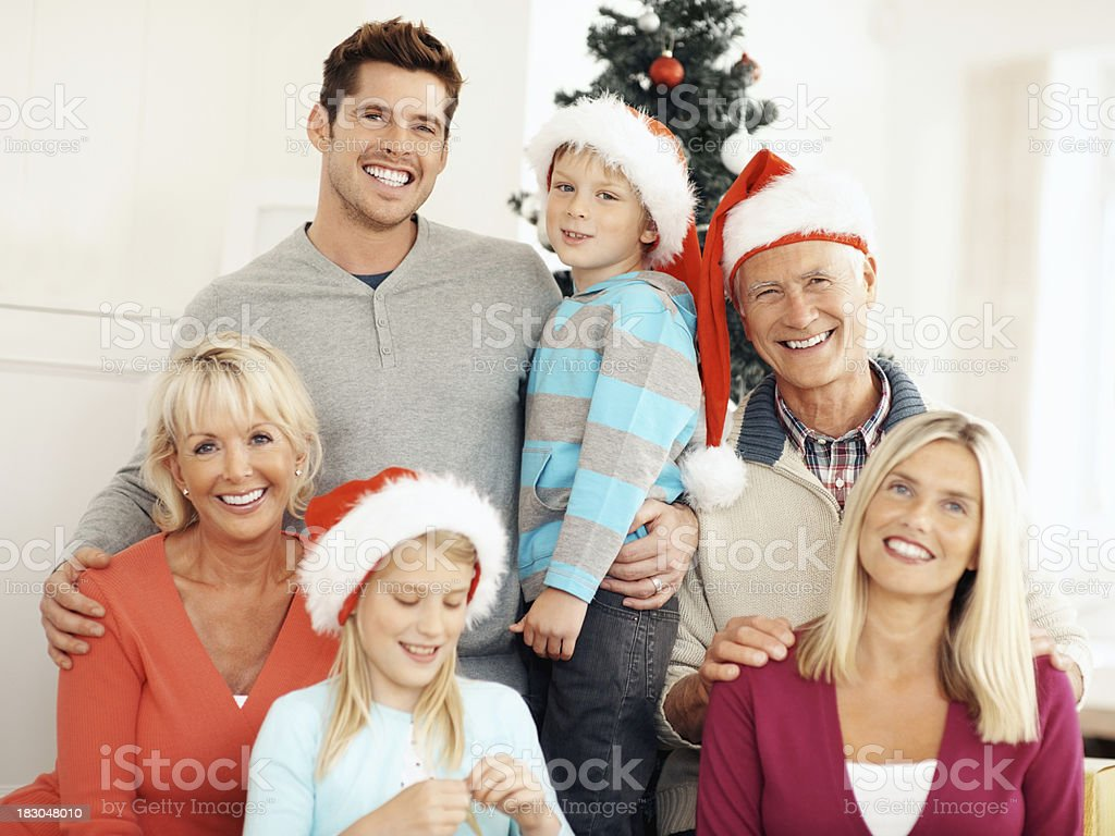 Smiling multi-generational family during Christmas royalty-free stock photo