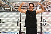 Smiling muscular man flexing muscle
