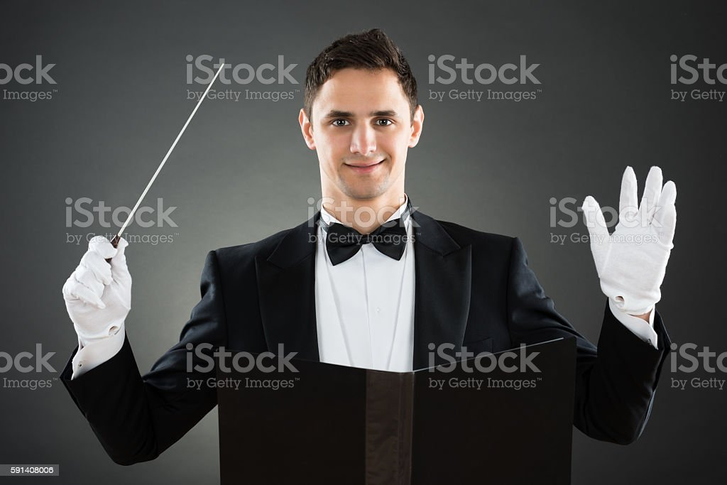 Smiling Music Conductor Holding Baton stock photo