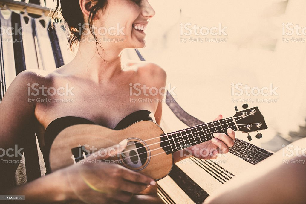 Smiling musician in the hammock stock photo