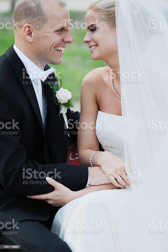 Smiling Newlywed Couple on Wedding Day royalty-free stock photo