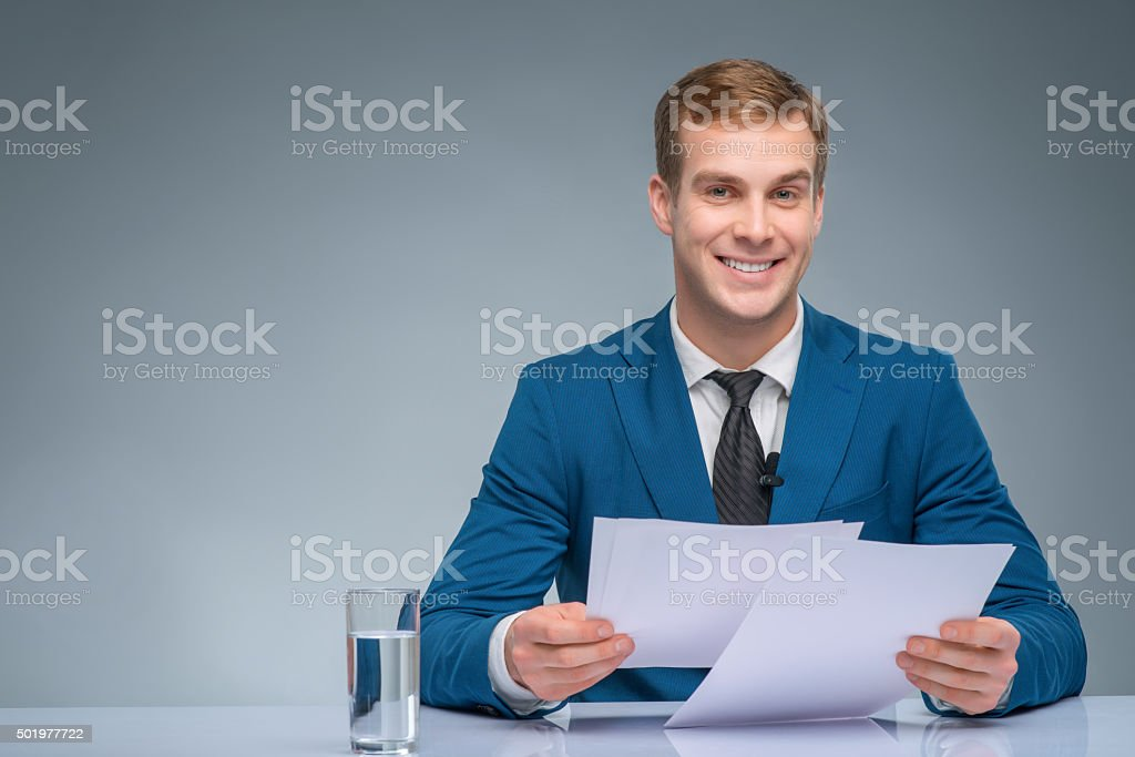 Smiling newscaster during broadcasting stock photo