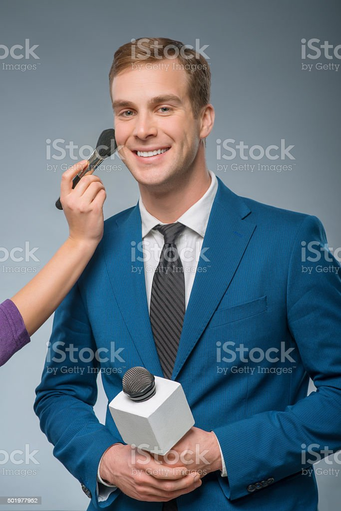 Smiling newscaster is being groomed stock photo