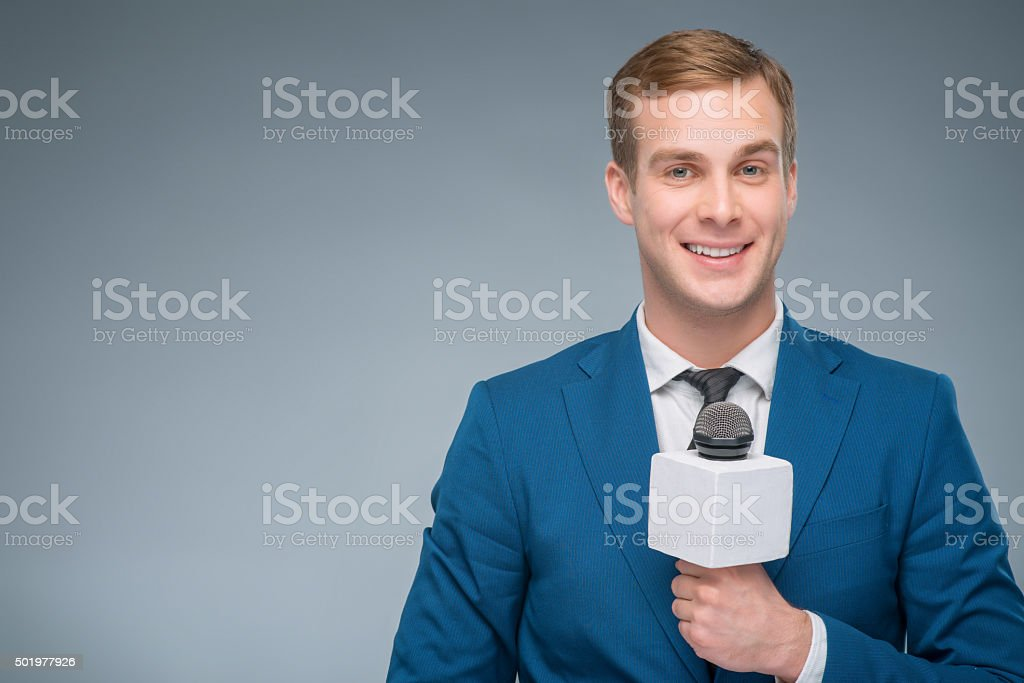 Smiling newsman holding a microphone stock photo