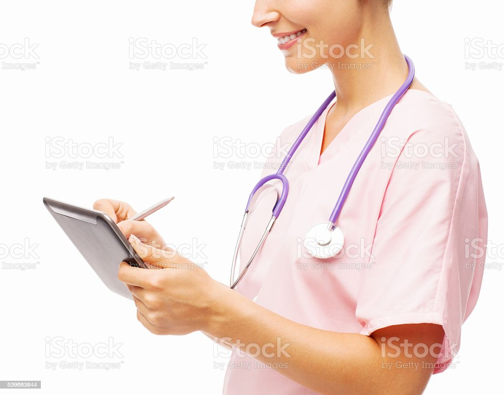 Smiling Nurse Using Digital Tablet With Digitized Pen stock photo