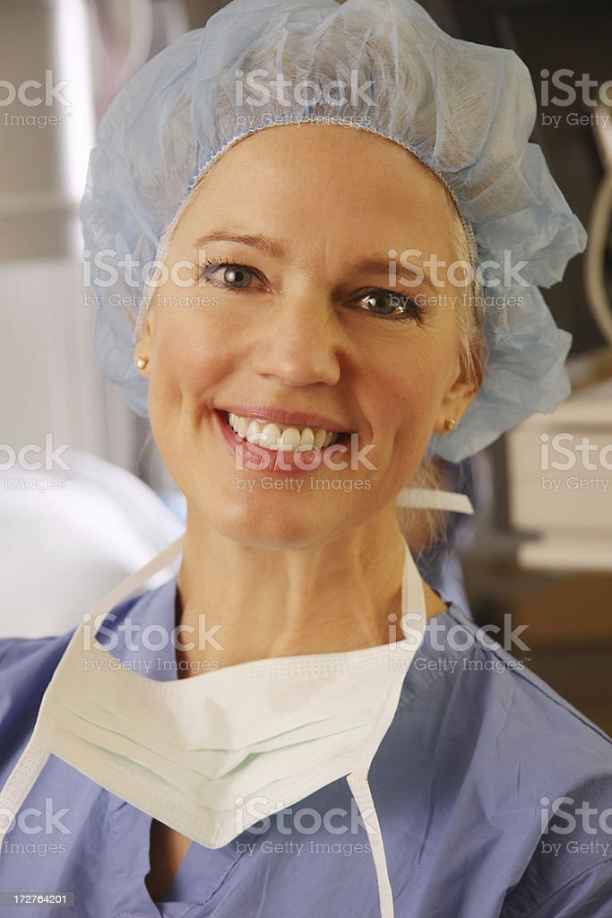 Smiling Nurse - with Hairnet and scrubs royalty-free stock photo