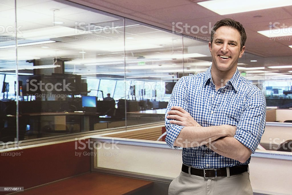 Smiling office worker looking at camera stock photo
