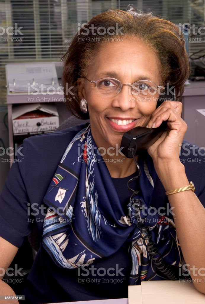 Smiling office worker on the phone royalty-free stock photo