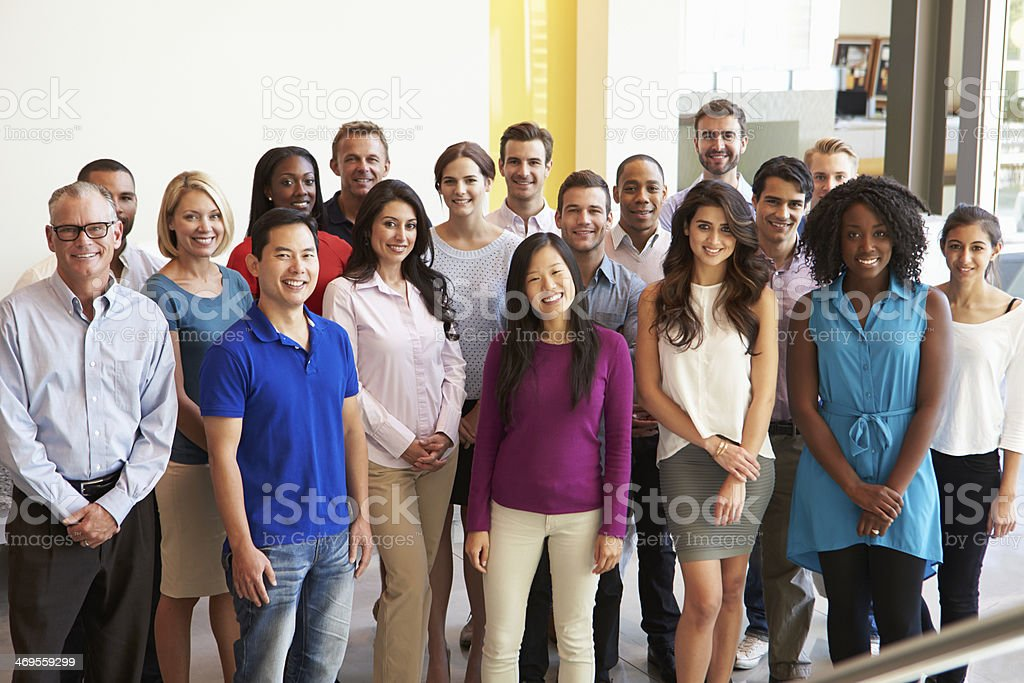 Smiling office workers pose for a group photo stock photo