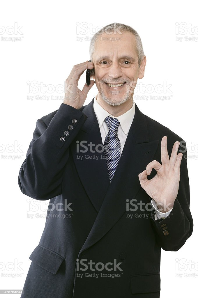 Smiling Okay Businessman on Phone stock photo