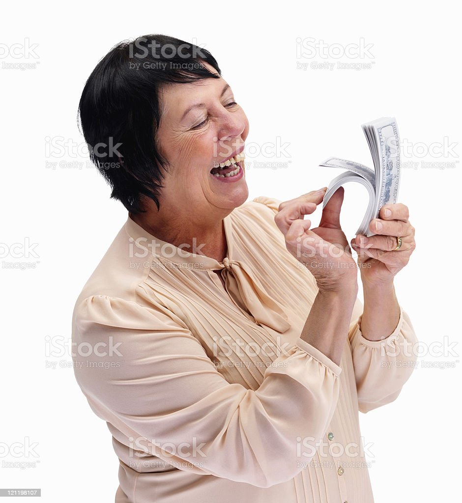 Smiling old lady counting currency notes on white royalty-free stock photo