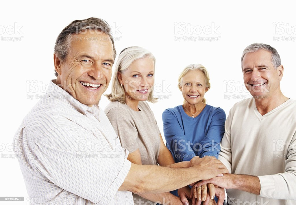Smiling old people holding their hands together on white royalty-free stock photo