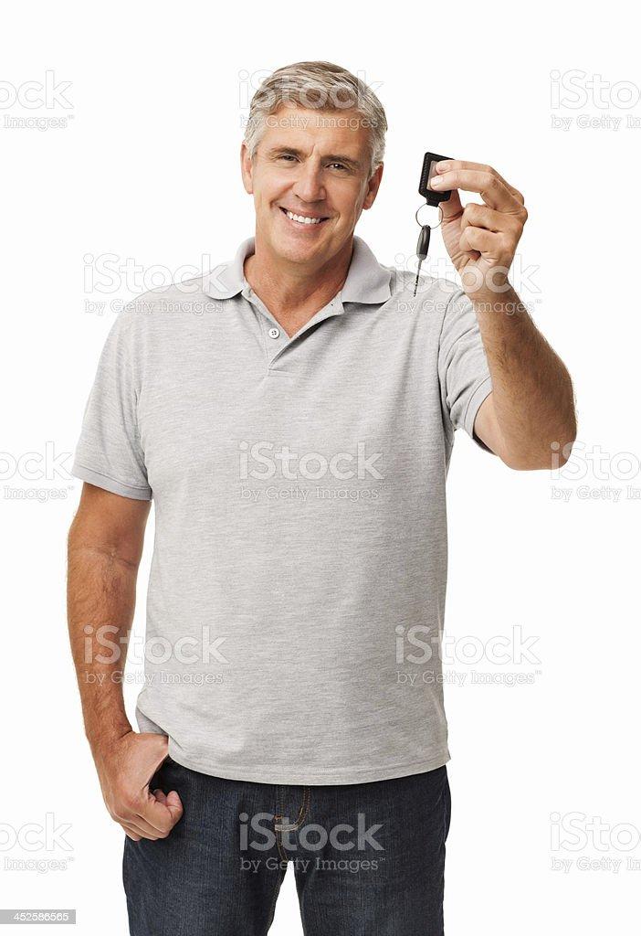 Smiling older man holding up new car key stock photo