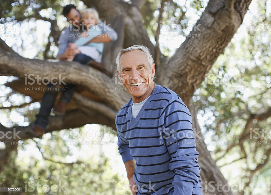 Smiling older man walking outdoors stock photo