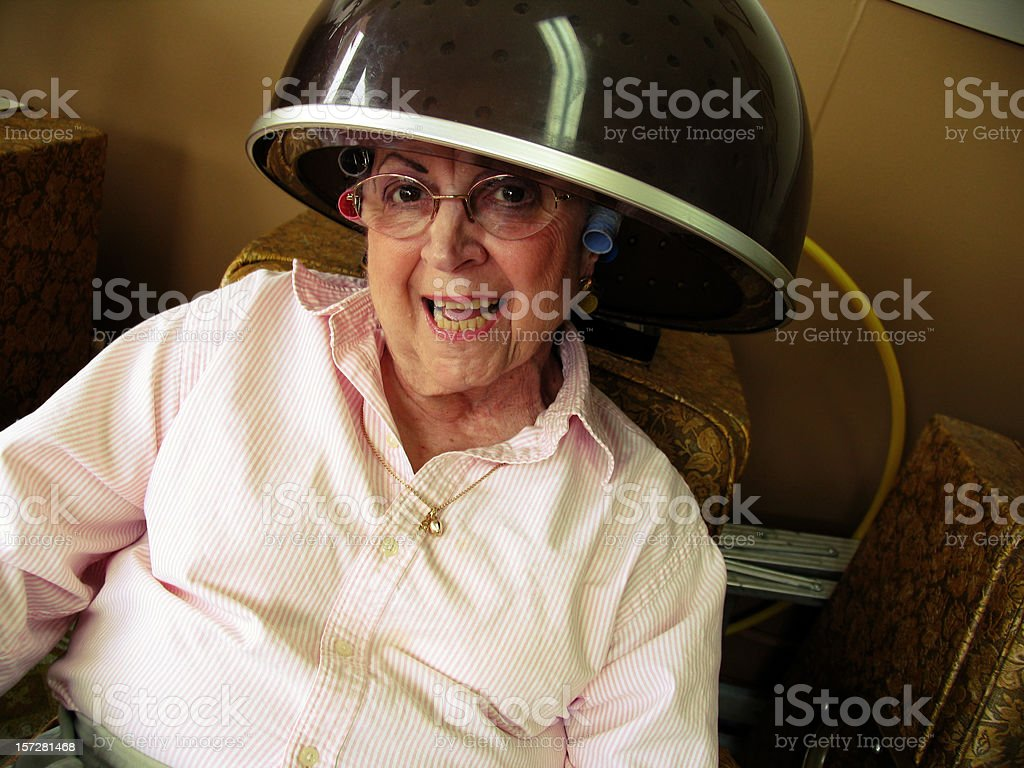 Smiling Older Woman Getting her Hair Dried royalty-free stock photo
