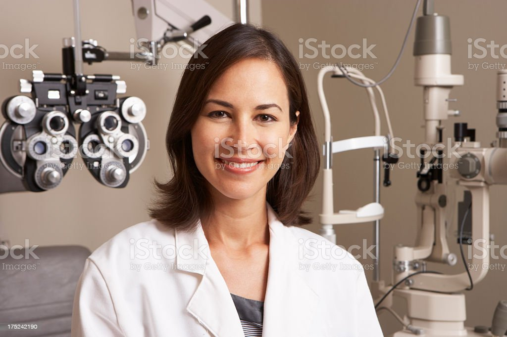 Smiling Optician in Surgery stock photo
