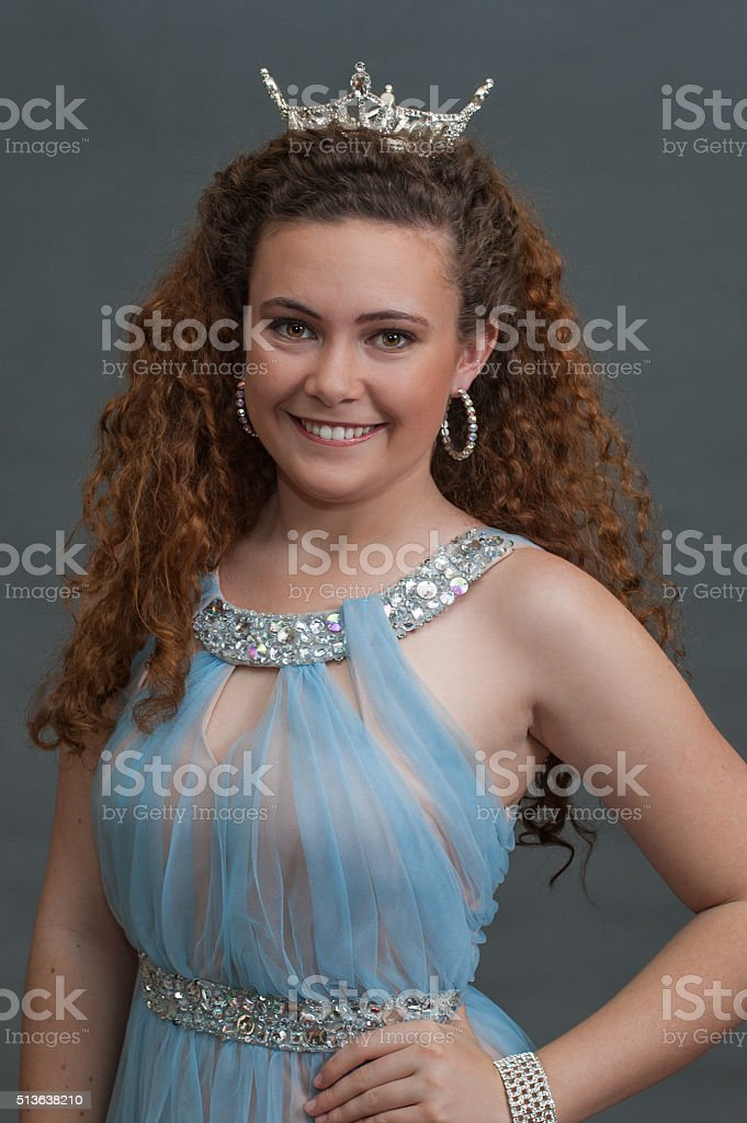 Smiling pageant queen facing ahead. stock photo