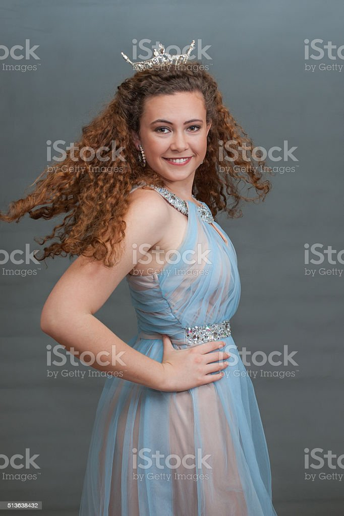 Smiling pageant queen facing right stock photo